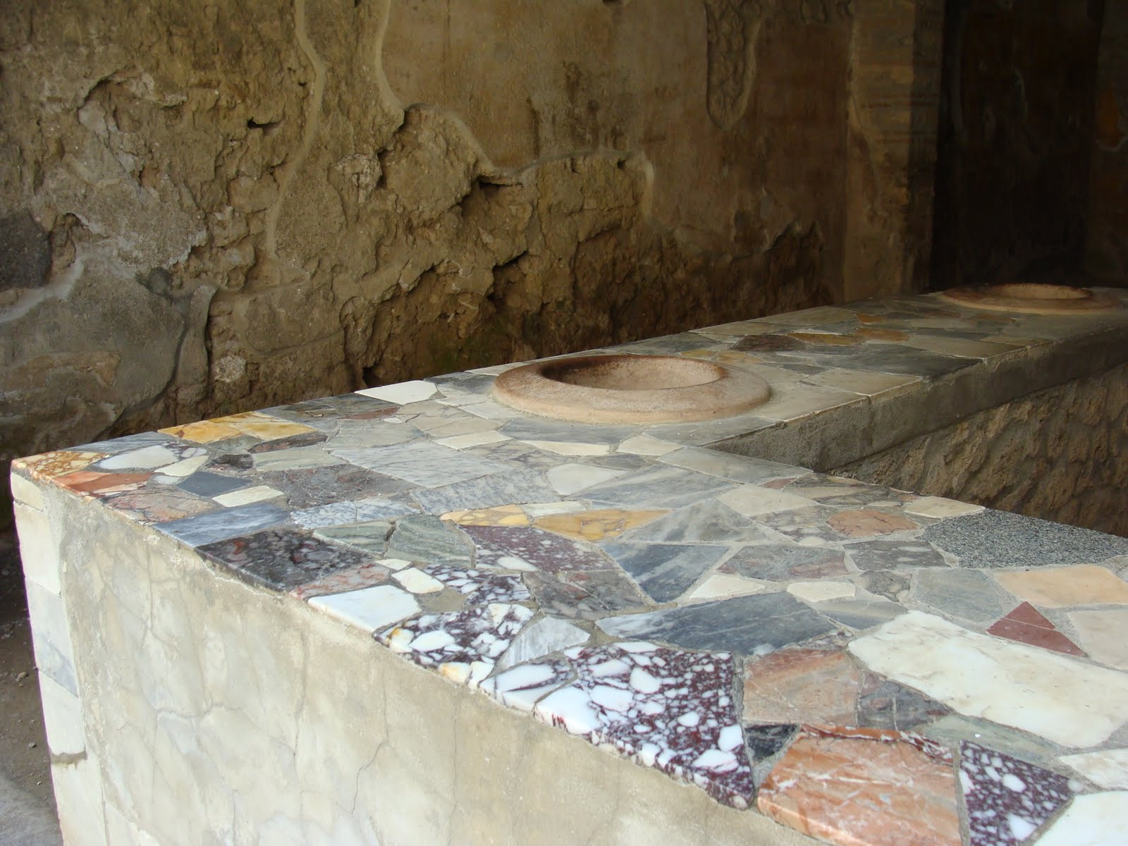 take a look at the bar below two thousand years later people are still making bars out of scraps of marble in the same way